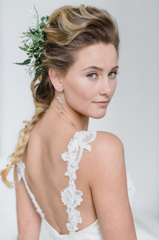 a neutral wedding dress paired with a greenery headpiece is a chic and romantic idea