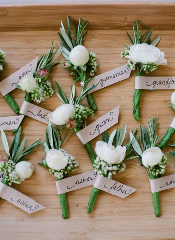cute boutonnieres of greenery and white blooms are great for grooms and groomsmen