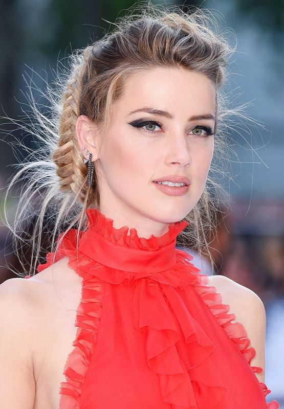 a textural braided updo with lots of hair up and a dimensional top is a creative idea with a boho feel