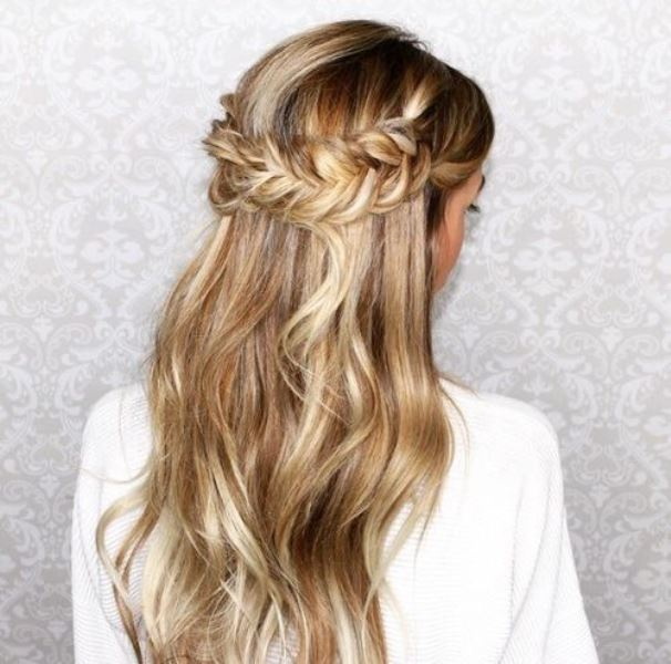 a wavy half updo with a fishtail braid halo is a very romantic and a bit rustic idea