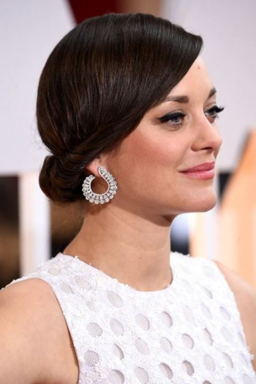 a sleek twisted low updo is a chic idea with a retro touch that will fit medium length hair