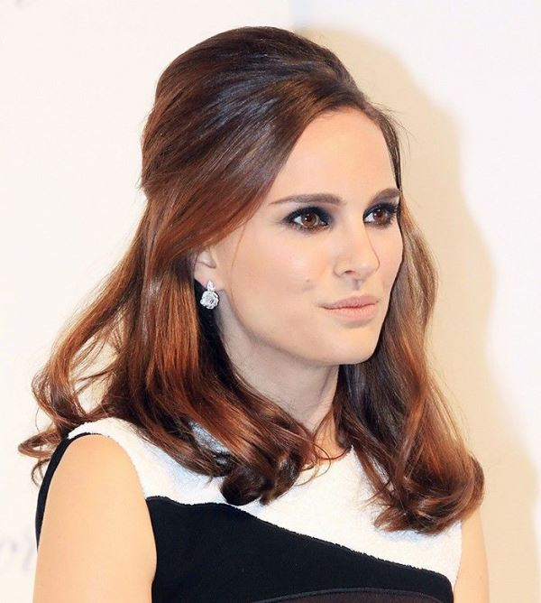 a retro half updo with a voluminous top and some waves down is a chic idea with a refined touch
