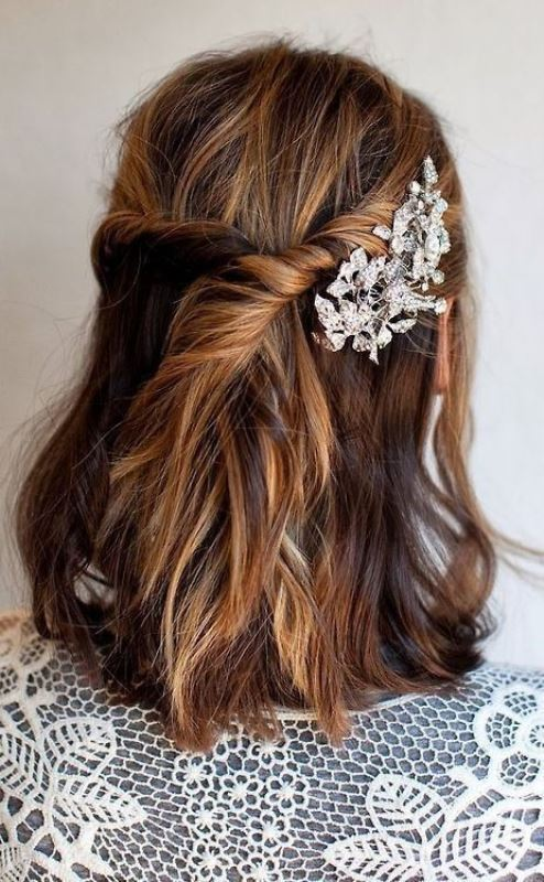 a messy textural half updo with a twisted part secured with a rhinestone florla hairpin for a romantic touch