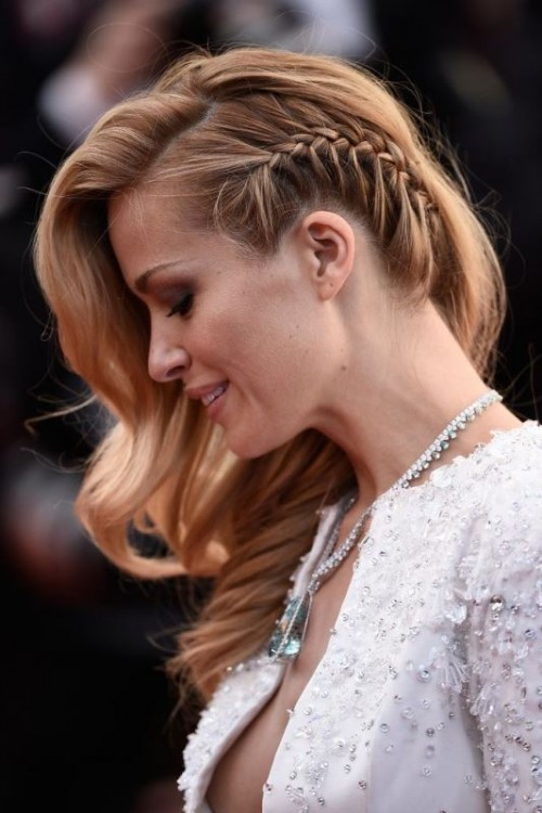 long wavy hair with a single side braid that accents the hairstyle and makes it more boho and free-spirited