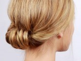 a low updo with a voluminous top is a chic idea for medium length hair