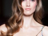 long wavy hair is always a cool and stylish idea for a modern bride, it will easily fit most of outfits