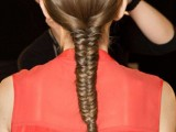 a long fistail braid with a sleek top is a stylish idea for a modern or minimalist bride