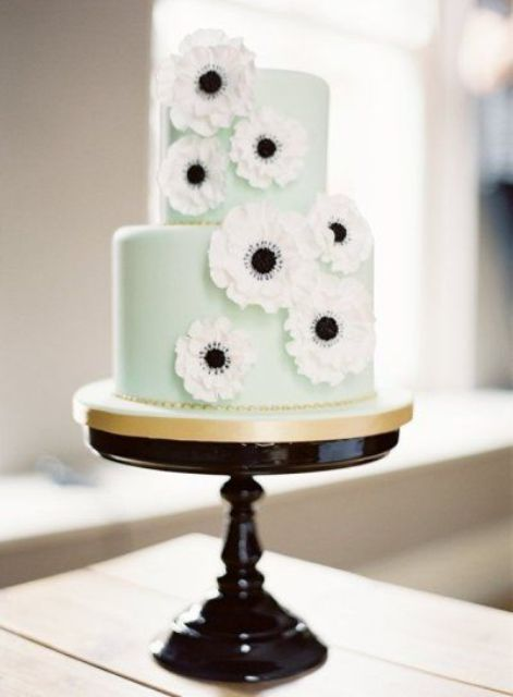 a romantic mint green wedding cake decorated with white sugar anemones for a spring or summer weddnig
