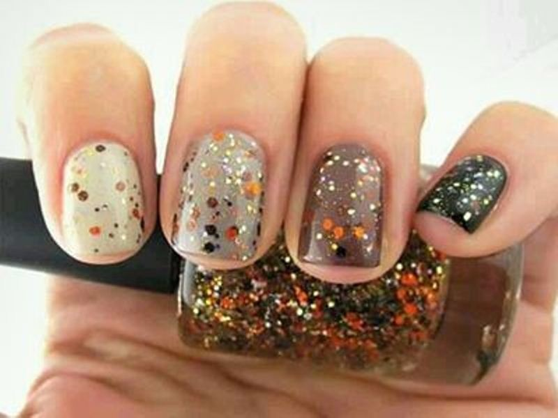 all different nails in fall colors with colorful sprinkles on them are lovely, cheerful and very fall like