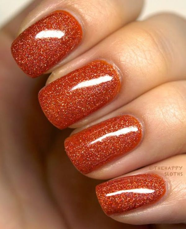 orange glitter nails feel like fall themselves, they will bring much color and a shiny touch to your look