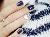 a navy manicure and an accent white and polka dot nail is stylish, chic and bold