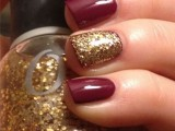 a burgundy manicure with a gold glitter accent nail is classics for a fall bride