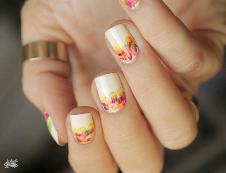 neutral nails with colorful brushstrokes will bring more color to your look and make your manicure fall inspired and bold