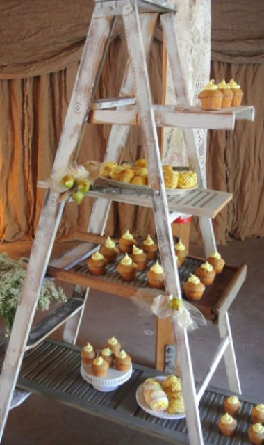 a wedding dessert stand made of a whitewashed ladder is a simple and creative idea that will save some space
