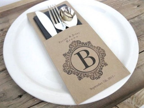 a personalized cardboard pocket with a dark napkin and stylish silver for styling your bbq rehearsal dinner