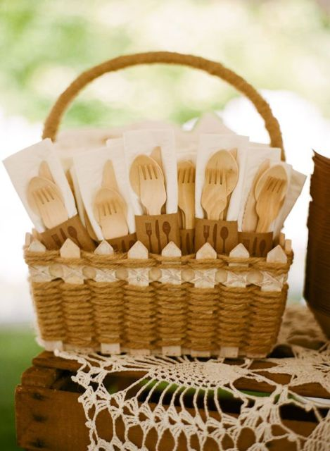 a basket decorated with lace and with wooden cutlery is a great idea for a light bbq rehearsal dinner, eco-friendly and all-natural
