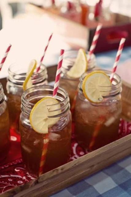 offer your guests iced tea with lemon poured into jars and with paper straws, it's a cool informal drink to serve
