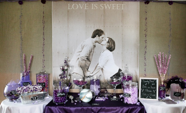 a cute candy bar done with purple touches, with a large photo of the couple instead of a sign and black, white and purple candies