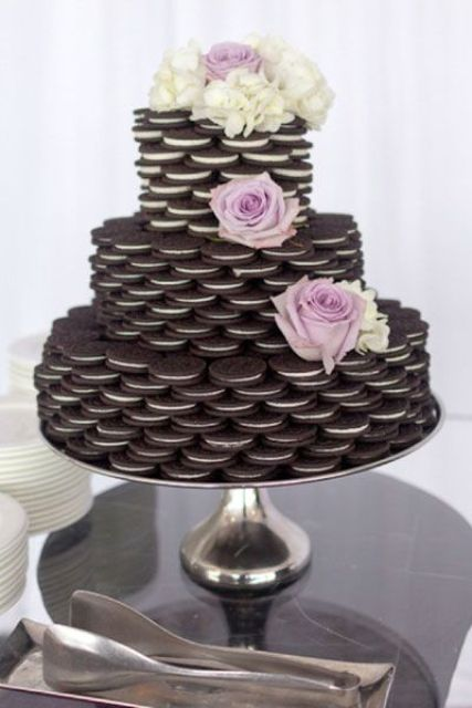 a cookie tower instead of a traditional wedding cake is a cool way to save some money and make the crowd pleased