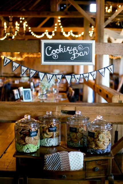 a tiny vintage cookie bar done with an elegant little table and some cookies in jars wiht chalkboard tags