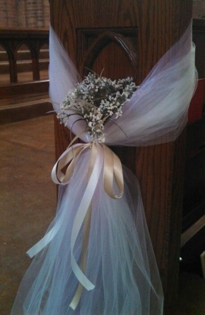 white tulle plus wildflowers and a silk bow to decorate the wedding aisle
