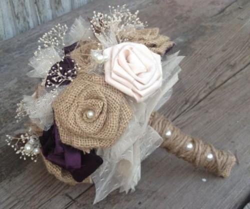 a fake flower wedding bouquet with a tulle and burlap wrap for a rustic wedding