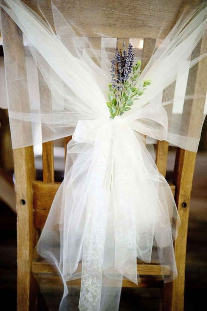 tulle reception chair decor with greenery and lavender for an elegant and chic touch