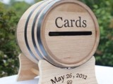 a wine barrel on a stand turned into a card box is a pretty idea for a wedding