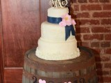 a wedding cake stand of a wine barrel is a lovely idea for a vineyard or rustic wedding