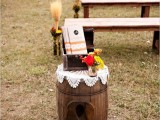 rustic wedding ceremony space decor with a barrel, a doily, bright blooms and an ampersand is a very cool idea