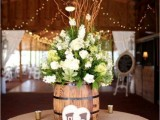 wine barrels as vases for floral arrangements and candles around is a lovely idea for a vineyard or a rustic wedding