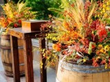 wine barrels as stands for floral arrangements will decorate botht he venue and the wedding ceremony space and make it brighter