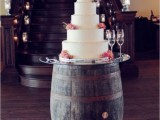a barrel as a wedding cake stand is a pretty and easy idea that doesn't require any changes or hacks