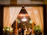 wine barrels turned into floral stands with lush arrangements and curtains on sides are great