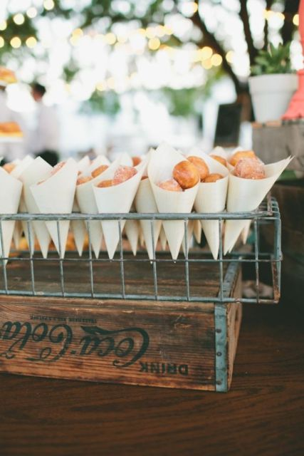 a wire stand with paper cones filled iwht mini donuts will make your guests happy at night