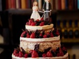 a krispie rice wedding cake with chocolate covers, lots of fresh berries and sugar toppers
