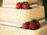a krispie rice wedding cake with ribbons and lace ribbons plus fresh strawberries is a delicious idea