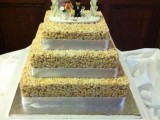 a square krispie rice wedding cake with white silk ribbons and a funny LEGO topper