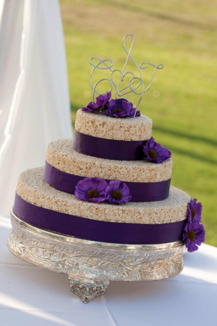 a krispie wedding cake with purple ribbons and blooms for a sophisticated wedding cake