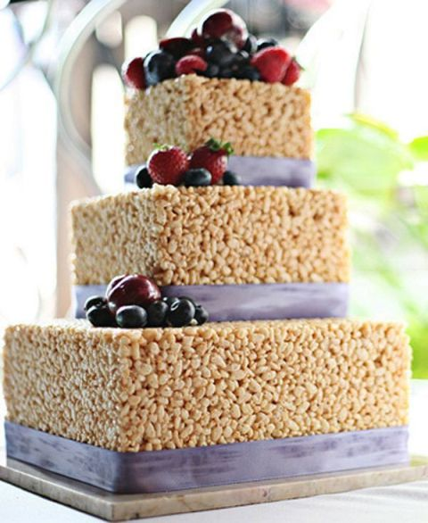 a square krispie rice wedding cake with lilac ribbons and fresh berries is a stunning and pretty idea