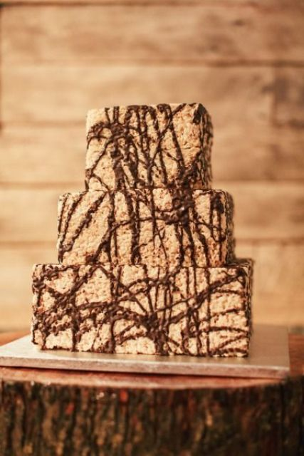 a square krispie rice wedding cake with chocolate drip is a fun modern idea to go for