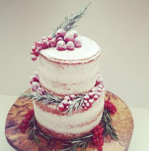 a naked wedding cake decorated with rosemary and sugared berries is a very delicious and stylish option for a winter wedding
