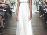 a statement empire waist wedding dress with a fully embellished bodice with cap sleeves and a pleated skirt