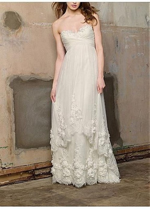 a strapless empire waist A-line wedding dress with a draped bodice, lace edges and a train is very sexy