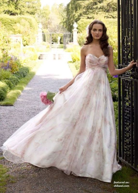 a strapless empire waist floral print wedding ballgown with a draped bodice is ideal for a spring or summer wedding