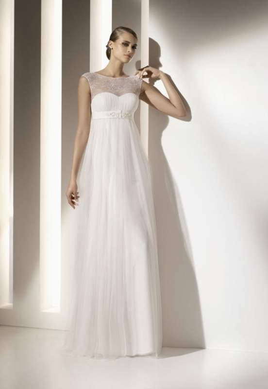a refined A line wedding dress with an illusion lace neckline, an empire wiast and a pleated skirt