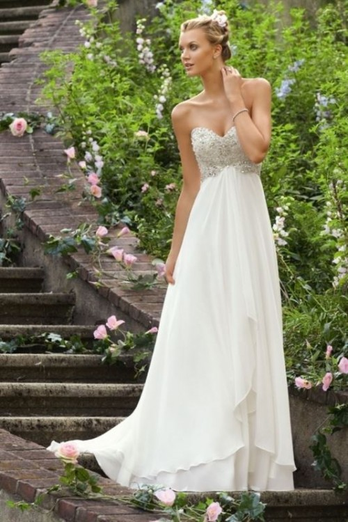 a strapless empire waist wedding dress with an embellished bodice, a layered skirt looks chic and elegant