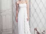 a strapless empire waist fitting wedding gown with a side slit with ruffles and a draped bodice for a sexy look
