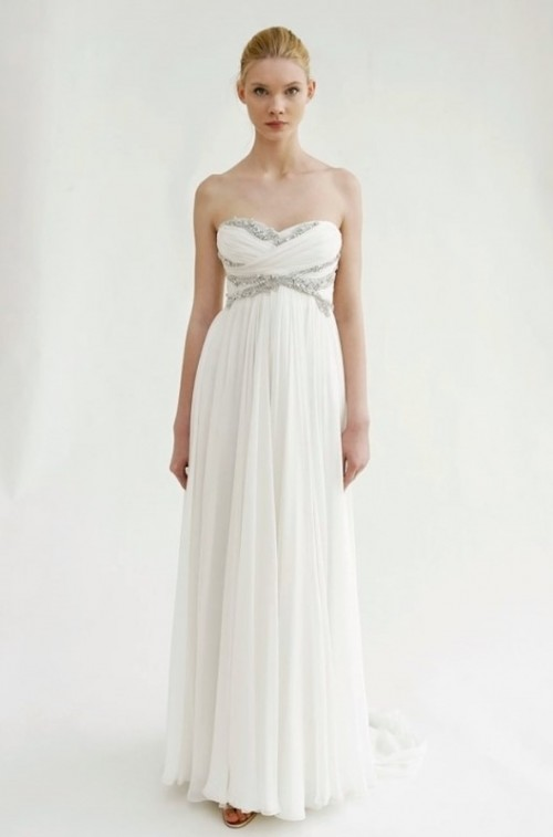 an exquisite strapless empire waist wedding dress with a draped bodice, a pleated skirt and embellishments