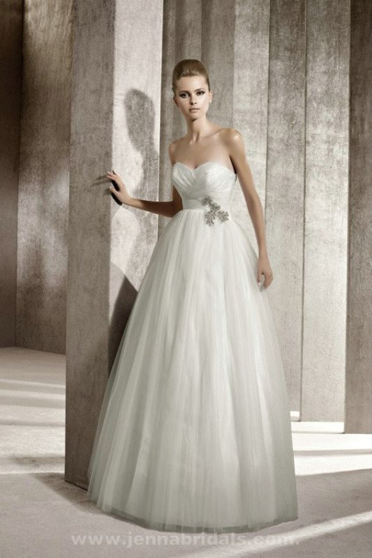 a strapless wedding ballgown with a draped bodice, an embellished sash and a full skirt
